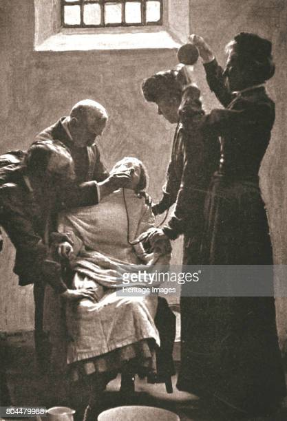 Suffragette being force fed with the nasal tube in Holloway Prison, London, 1909. In response to their hunger strikes several suffragettes were...