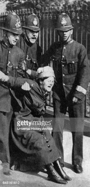 Suffragette being restrained by the police