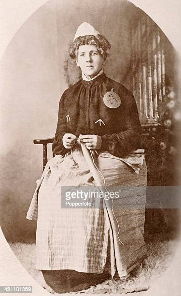 Suffragette Emily Hayes Duval a prisoner at Holloway Prison in London in prison uniform and sewing mail bags circa 1908