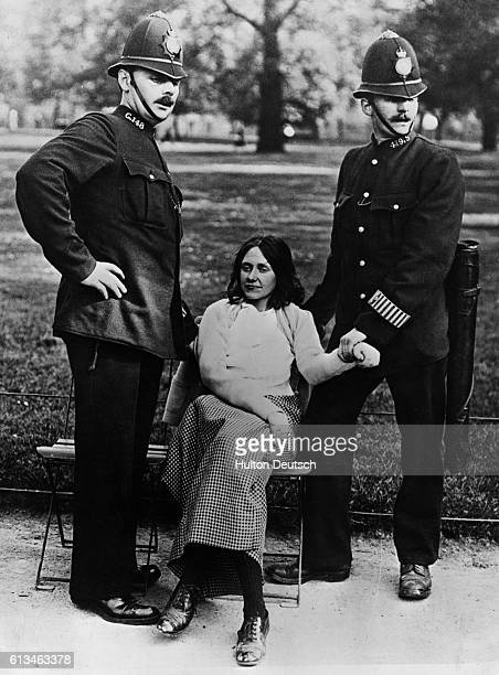 A suffragette is arrested in a London park after a raid on Buckingham Palace London