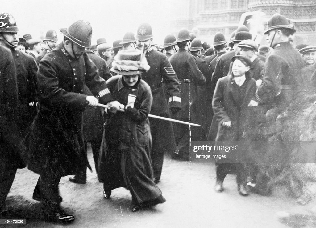 A suffragette struggling with a policeman on 'Black Friday', 18th November 1910. : News Photo