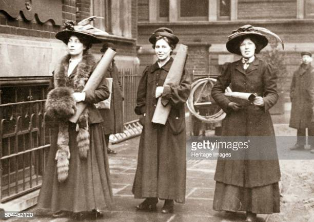 Suffragettes armed with materials to chain themselves to railings, 1909. The Suffragettes found that by chaining themselves to railings they could...