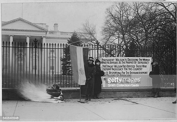 Suffragettes' bonfire and posters at the White House Washington District of Columbia 1917 Image courtesy National Archives