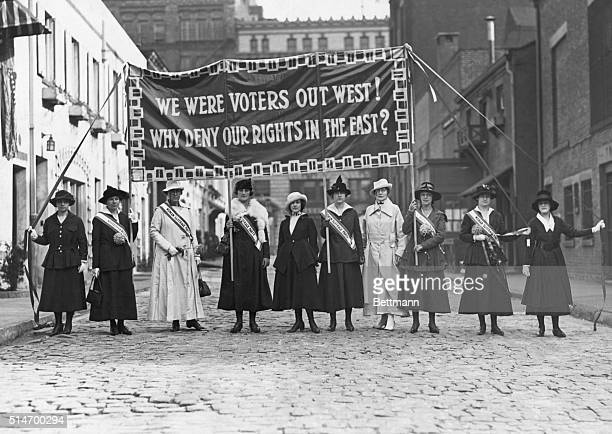 Suffragettes displaying banners at Washington Mews in Greenwich Village New York City ca 1912