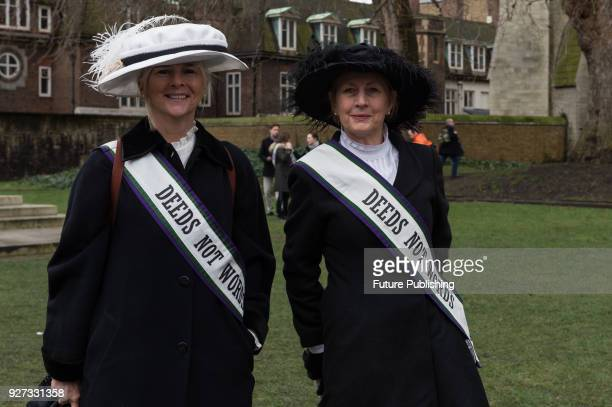 Suffragettes gather at Old Palace Yard outside the Houses of Parliament in London to take part in March4Women, an annual event to celebrate...