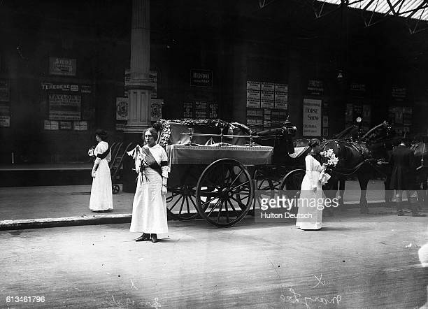 Suffragettes Mary Leigh and Mrs Yates stand guarding the coffin of their fellow campaigner Emily Davison who was killed making a protest at the 1913...