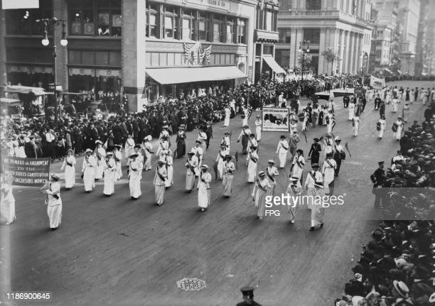 Suffragettes of the Congressional Union for Woman Suffrage marching during a parade in New York City, US, circa 1913; the women at the front are...