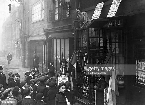 Suffragettes Paint Their Own Shop Front Womens Social Defence League Bow St East London Miss Sylvia Pankhurst takes advantage of the gathered crowd...
