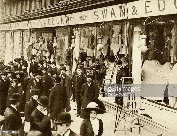 Suffragettes smashing windows on Regent Street in 1912