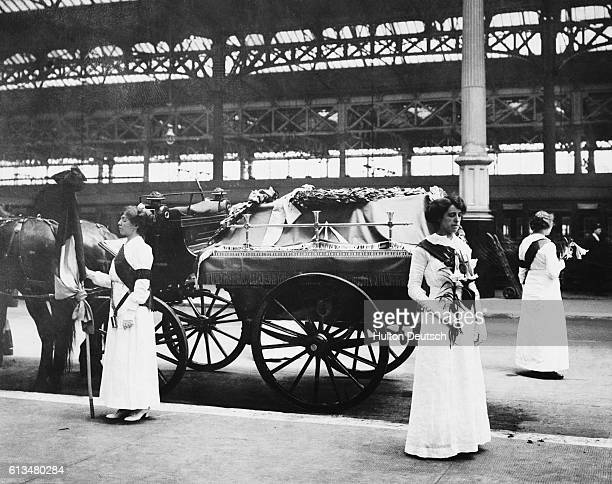 Suffragettes stand with the coffin of their fellow campaigner Emily Davison at Victoria Station She died making a protest at the 1913 Epsom Derby...