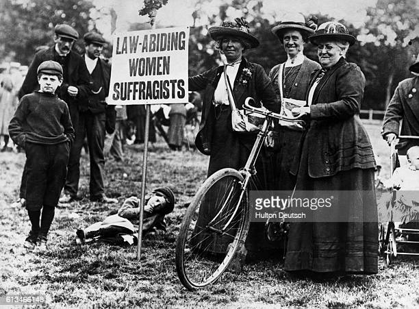 Suffragettes who cycled from various parts of England to London to attend a 1913 meeting advertise that they are law abiding so as to distinguish...