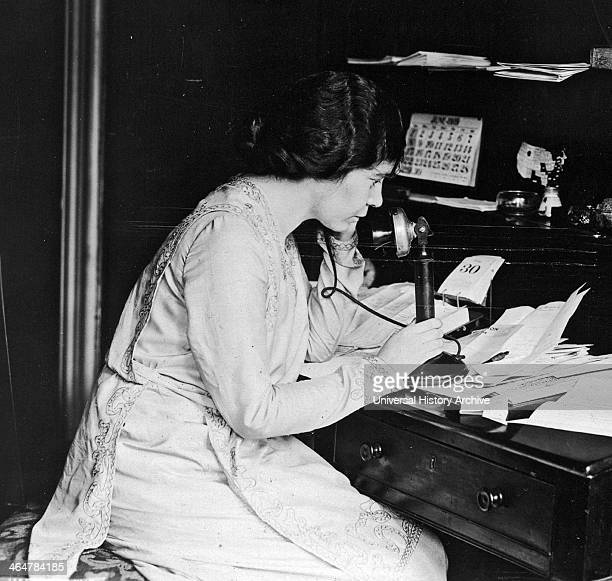Suffragist Alice Paul using telephone