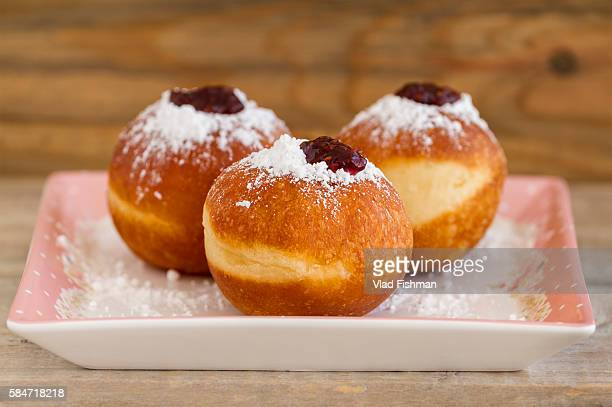 sufganiot, doughnuts. a traditional jewish hanukah dessert - hanukkah stock pictures, royalty-free photos & images