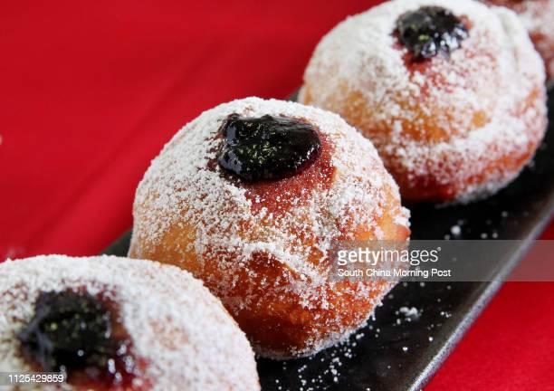 Sufganiyot filled with blackberry jam made by chef Michael Erlik. 06NOV12