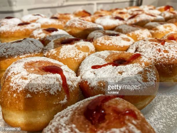 sufganiyot in bakery store - sufganiyah stock pictures, royalty-free photos & images