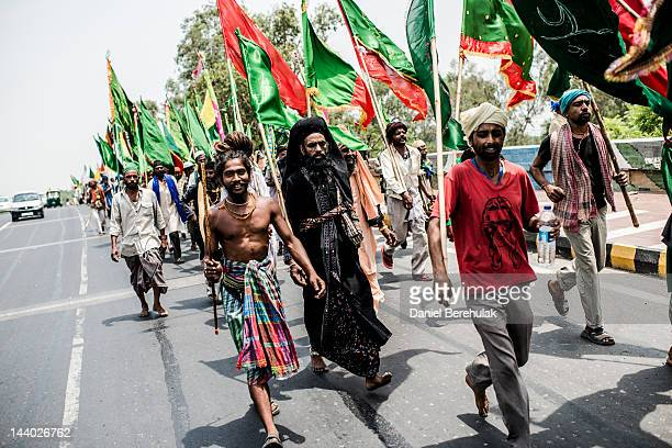 Sufi Devotees walk along a street during a pilgrimage to Ajmer on May 8 2012 in New Delhi India Sufi pilgrims from all over the world are making the...