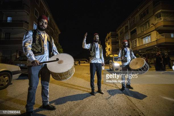 Sufi music soloist Eren Coskun and drummers Haydar Kocadere and Emir Cosan perform sufi music to wake people for 'sahur' meal the last meal before a...