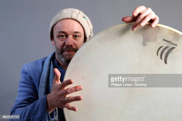 sufi musician. paris, france. - percussion instrument stock photos and pictures