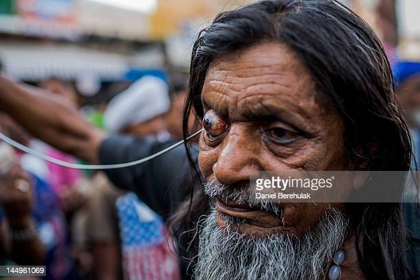 Sufi Muslim pilgrim Kale Baba who walked for 13 days from New Delhi as part of the pilgrimage selfflagellates during a procession on May 21 2012 in...