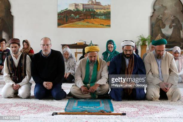 Sufi muslims praying in a catholic monastery. France.