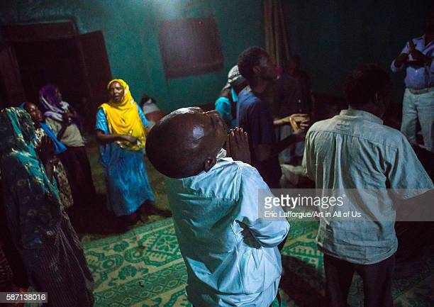 Sufi people go into a trance during a ceremony harari region harar Ethiopia on March 4 2016 in Harar Ethiopia