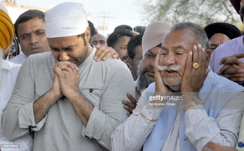 Sufi Singer Padma Shri Ustad Puran Chand Wadali and his son Singer Lakhwinder Wadali weep during cremation of his younger brother Pyarelal Wadali at..