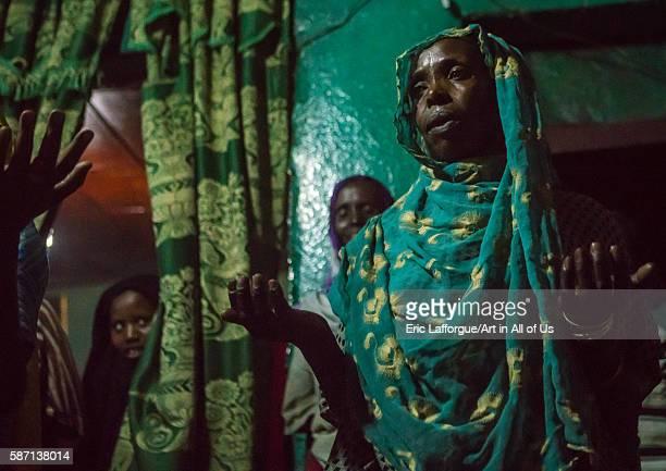 Sufi women go into a trance during a ceremony, harari region, harar, Ethiopia on March 4, 2016 in Harar, Ethiopia.