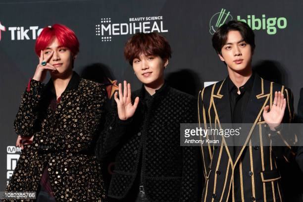 V Suga and Jin of BTS attend the 2018 Mnet Music Awards in Hong Kong at AsiaWorld–Expo on December 14 2018 in Hong Kong Hong Kong