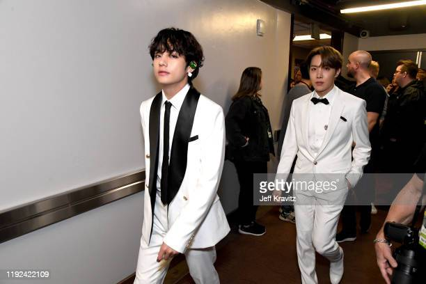 Suga and V of BTS attend 102.7 KIIS FM's Jingle Ball 2019 Presented by Capital One at the Forum on December 6, 2019 in Los Angeles, California.