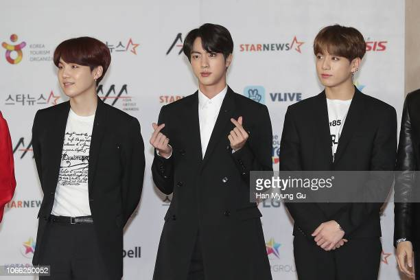 Suga Jin and JungKook of boy band BTS attend the 2018 Asia Artist Awards on November 28 2018 in Incheon South Korea