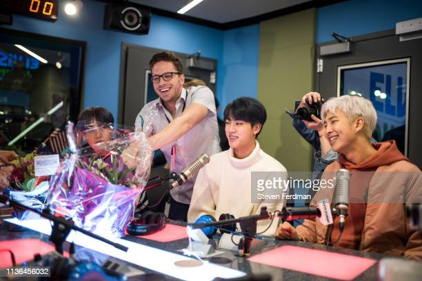 Suga Jin and RM of BTS visit The Elvis Duran Z100 Morning Show at Z100 Studio on April 12 2019 in New York City