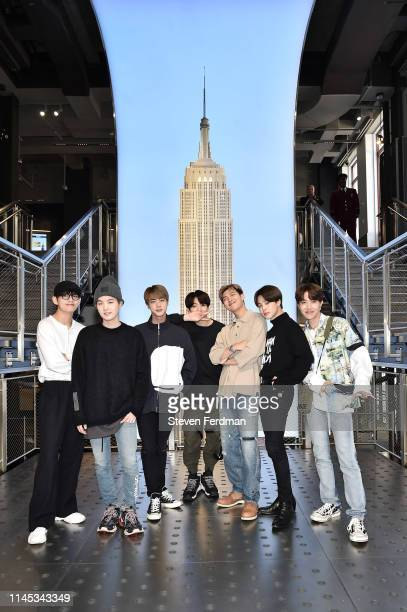 Suga, Jin, Jungkook, RM, Jimin, and J-Hope of the K-Pop Group BTS visit The Empire State Building on May 21, 2019 in New York City.