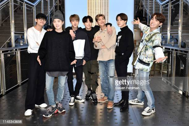 V Suga Jin Jungkook RM Jimin and JHope of the KPop Group BTS visit The Empire State Building on May 21 2019 in New York City