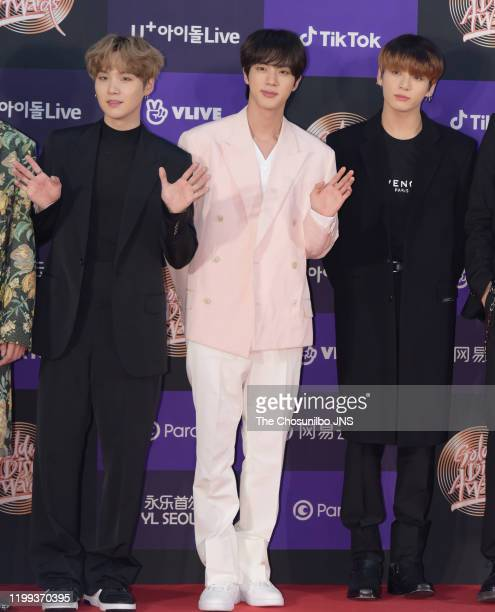 Suga Kim SeokJin Jungkook of Bangtan Boys arrive at the photocall for the 34th Golden Disc Awards on January 05 2020 in Seoul South Korea
