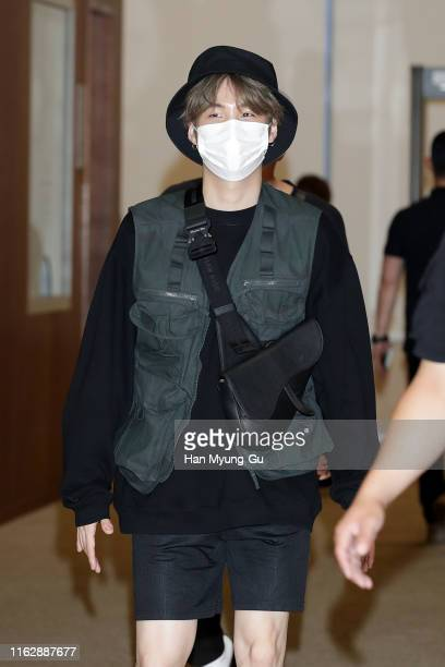 Suga of boy band BTS aka Bangtan Boys is seen upon arrival at Gimpo Airport on July 17 2019 in Seoul South Korea