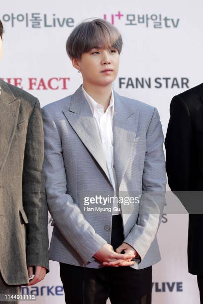 Suga of boy band BTS attends the photocall for U Plus 5G 'The Fact Music Awards' on April 24 2019 in Incheon South Korea