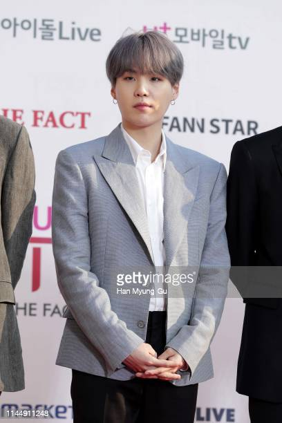 Suga of boy band BTS attends the photocall for U Plus 5G 'The Fact Music Awards' on April 24, 2019 in Incheon, South Korea.