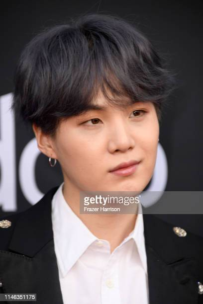 Suga of BTS attends the 2019 Billboard Music Awards at MGM Grand Garden Arena on May 01 2019 in Las Vegas Nevada