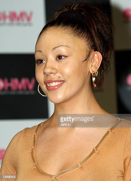 Sugababes member Mutya attends a music event at HMV Oxford Street August 29 2002 in London England The Sugababes gathered to perform songs from their...
