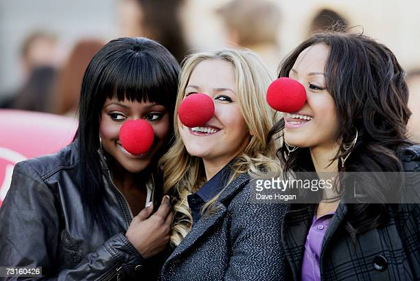 Sugababes members Keisha Buchanan Heidi Range and Amelle Berrabah pose at a photocall to launch this year's Comic Relief events at the London Eye on...