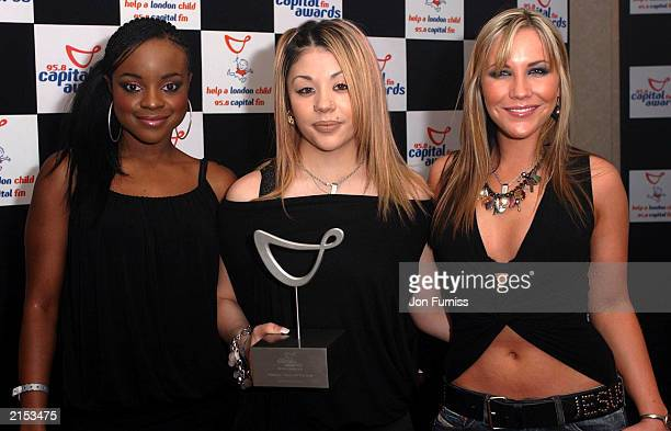 Sugababes pose with their award at The Capital FM Awards for Help A London child held at The Royal Lancaster Hotel on April 16 2003 in London England