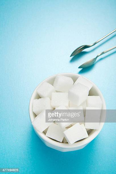 sugar bowl of sugar-cubes - sugar bowl crockery stock photos and pictures