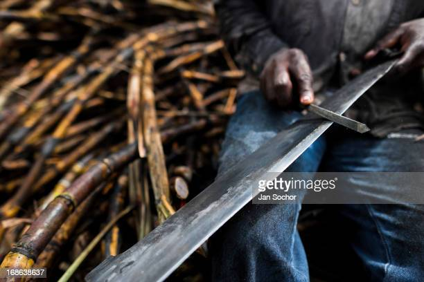 A sugar cane cutter sharpens his machete on a plantation near Florida Valle del Cauca Colombia 25 May 2012 The Cauca River valley is the booming...