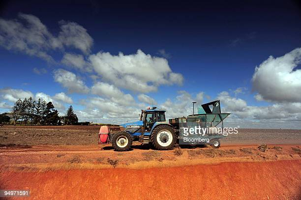 Sugar cane farmer Jay Hubert plants a new crop using a GPSguided tractor in Bundaberg Queensland Australia on Friday Aug 14 2009 The 86 percent surge...