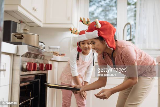 sugar cookies with mom - filipino christmas family stock pictures, royalty-free photos & images