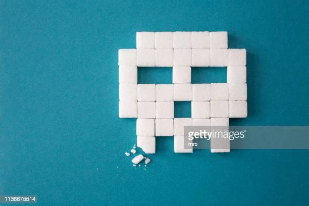 sugar cubes in the shape of skull - sucre photos et images de collection