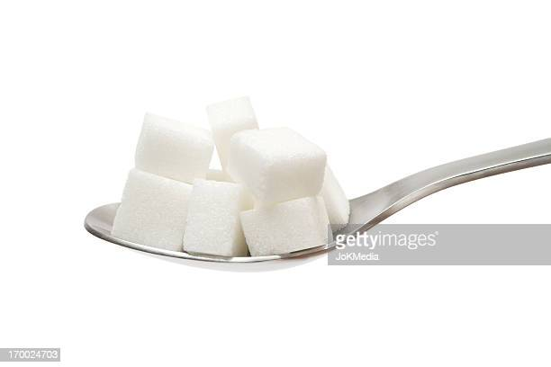 sugar cubes on spoon - sugar pile stock pictures, royalty-free photos & images