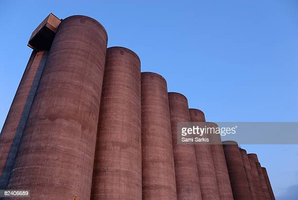 sugar factory silo at dusk, france - silo stock photos and pictures