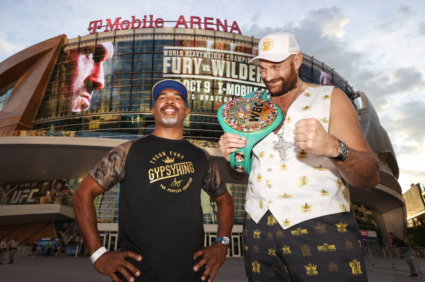 Sugar Hill Steward and WBC heavyweight Champion Tyson Fury pose during the grand arrivals at T-Mobile Arena on October 05, 2021 in Las Vegas, Nevada.
