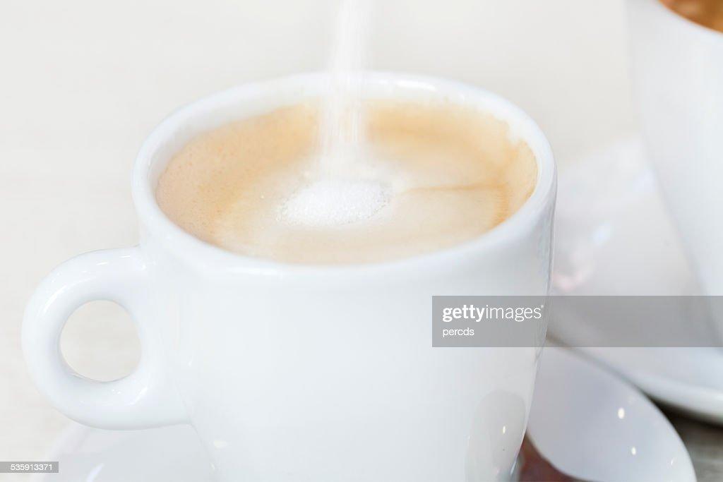 Sugar in the cappuccino : Stock Photo